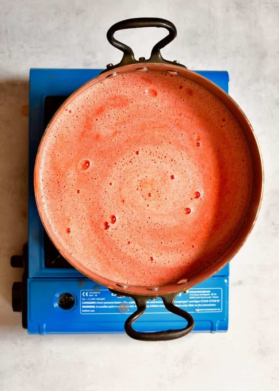 Heating up tomato juice in a pot