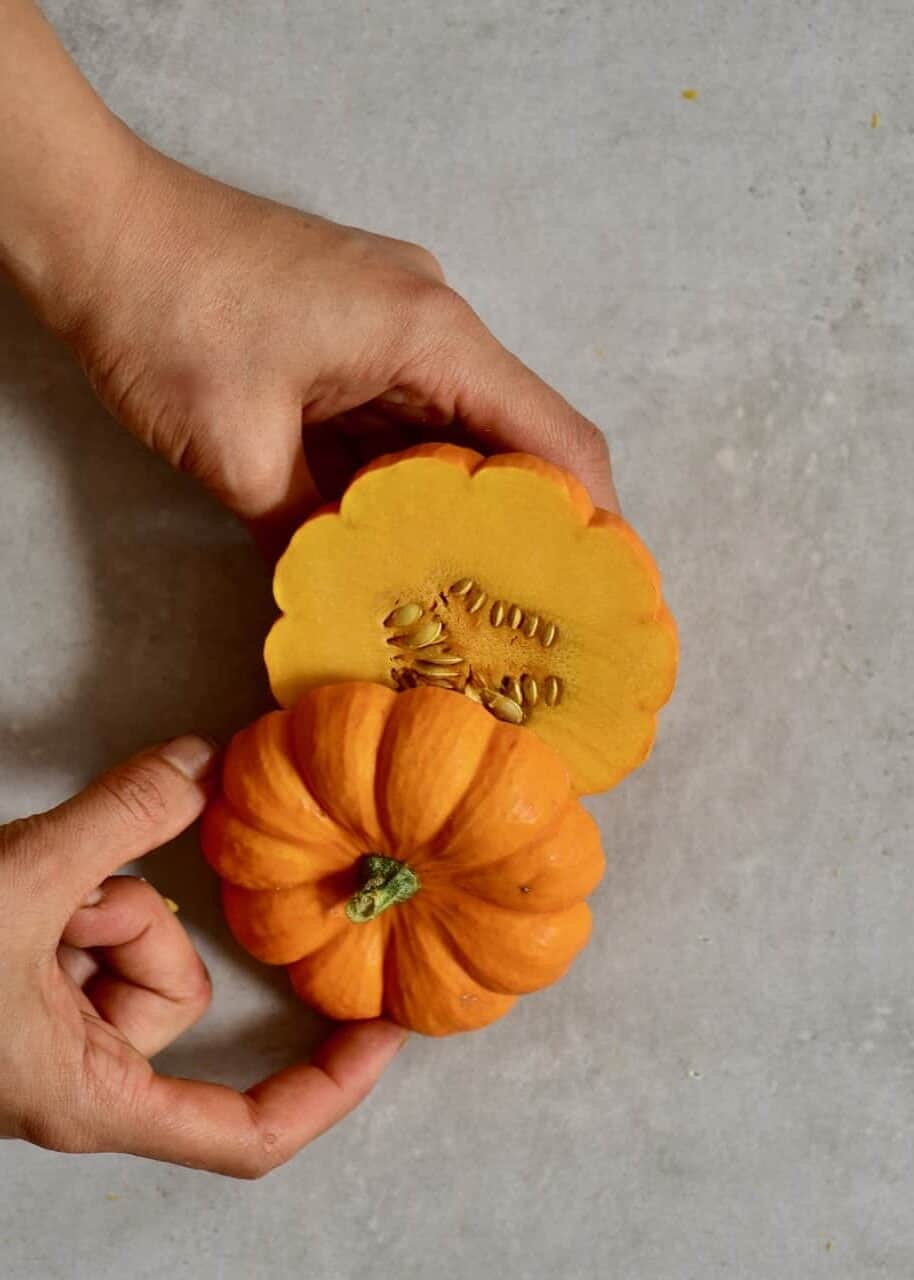 Cutting mini pumpkin in two