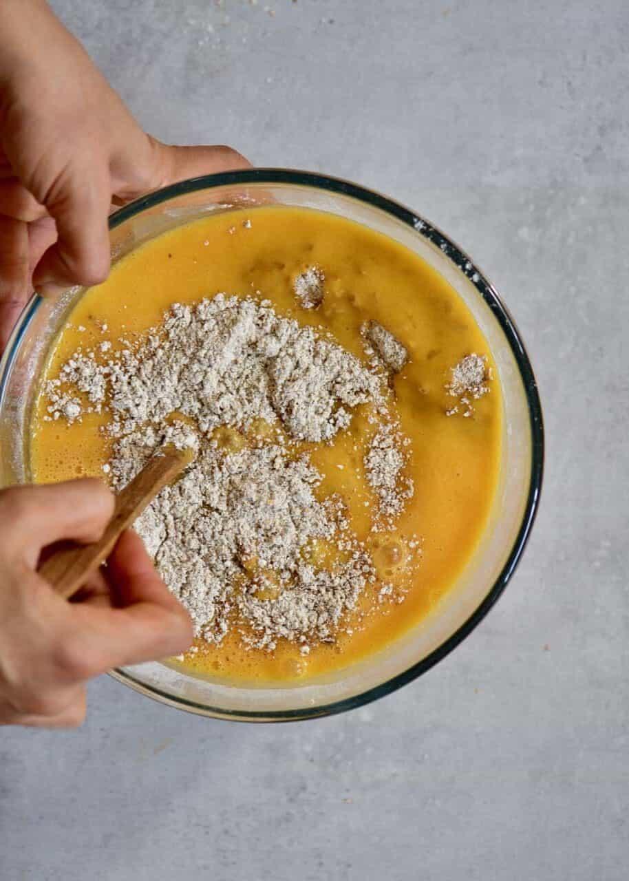 Mixing ingredients in bowl to make cake batter