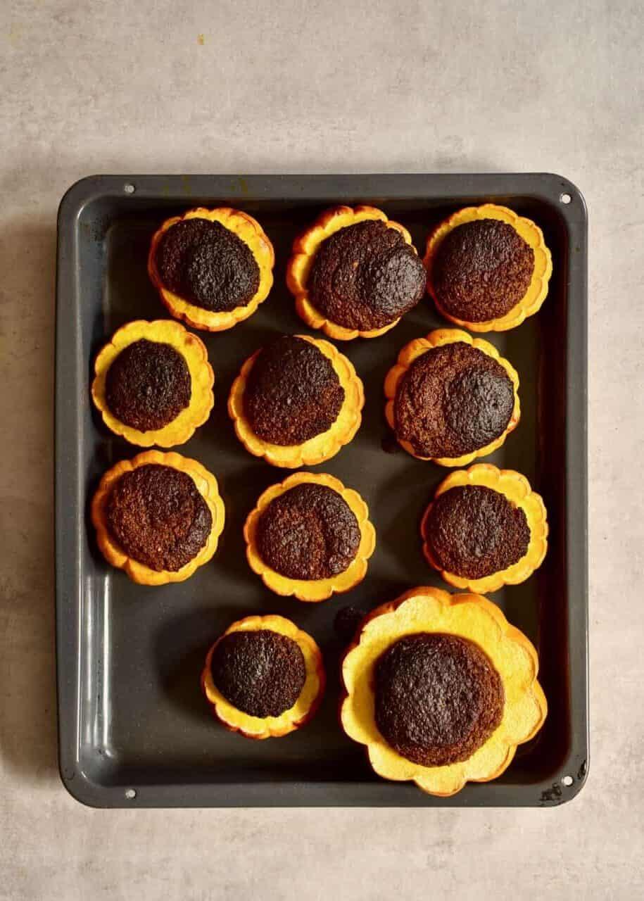 Baked mini pumpkin cakes on a tray