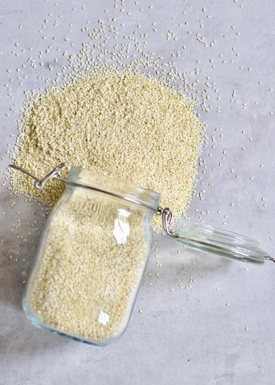 sesame seeds spilling out of a jar