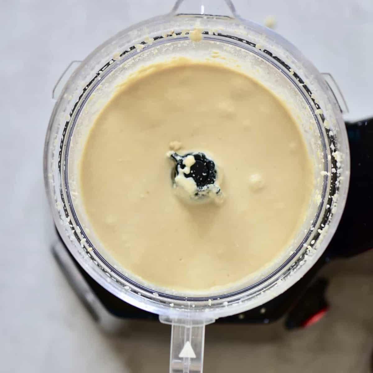 blended sesame seeds in a blender