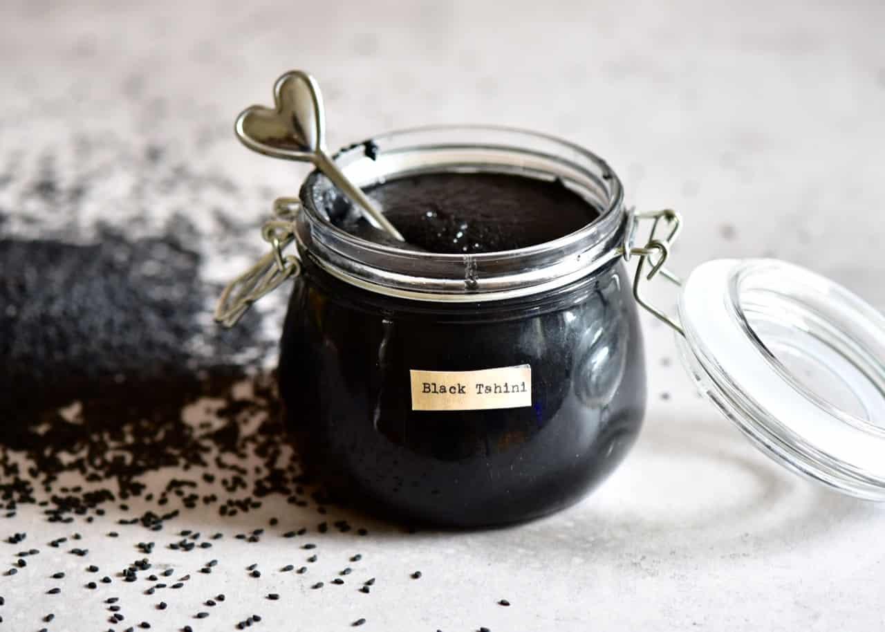 two ingredient homemade black tahini using unhulled black sesame seeds