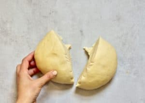 chopping vegan dough in half