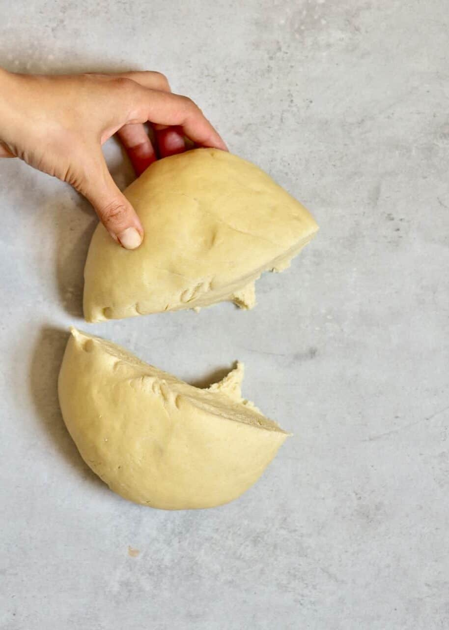 Cutting dough in two