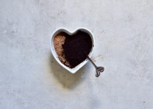 mixture of normal and black cacao in heart shaped bowl