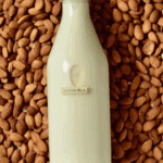 almond milk in a bottle and almonds under it