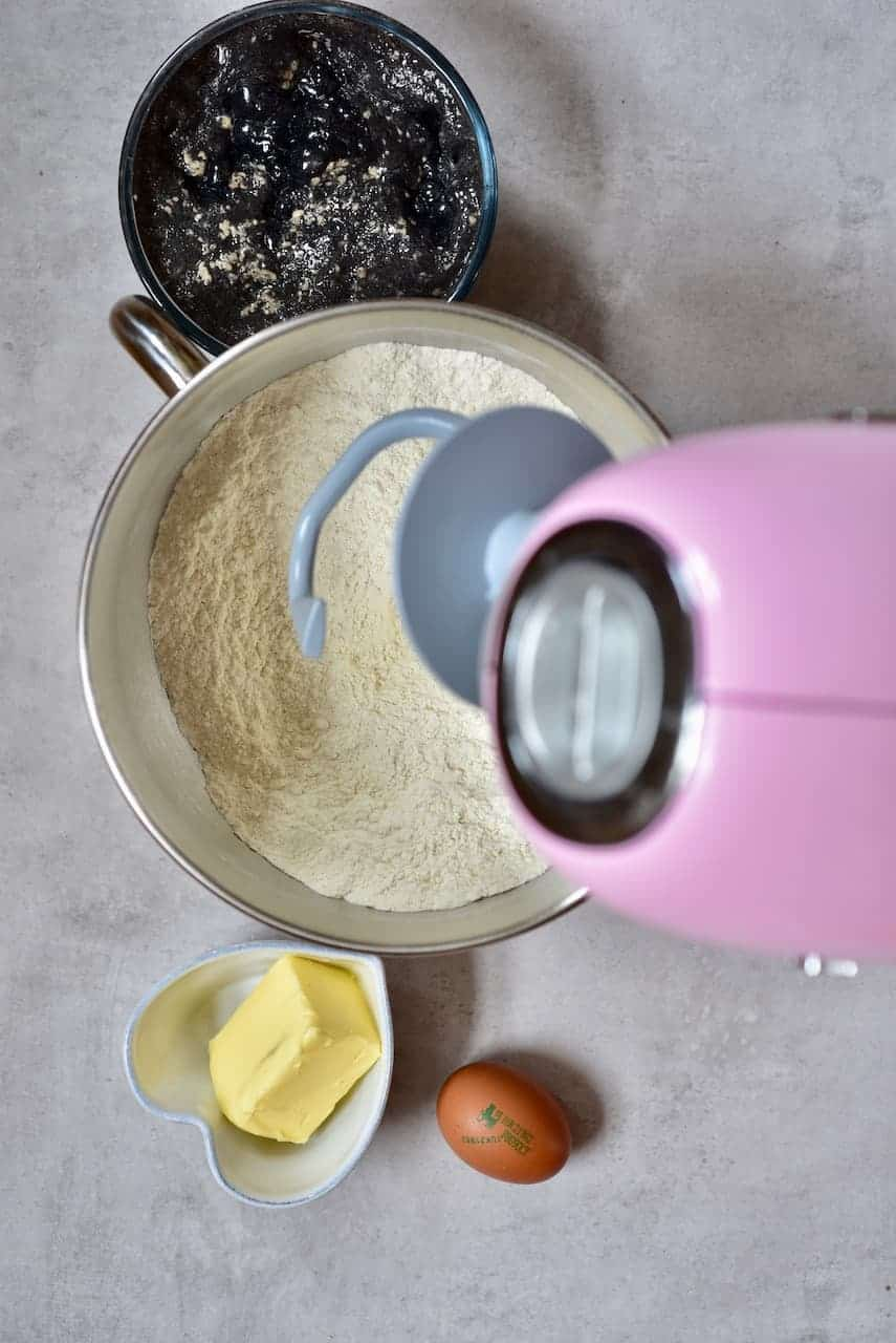 ingredients for black brioche buns waiting to be kneaded by stand mixer