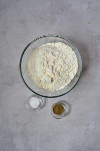 flour, salt and , herbs in bowls