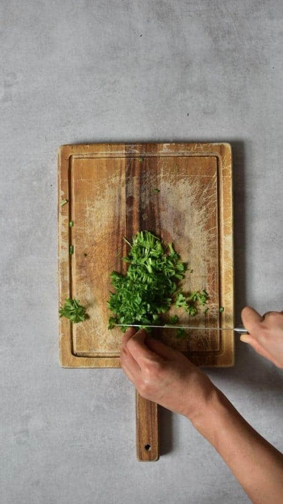chopping fresh herbs for a salad
