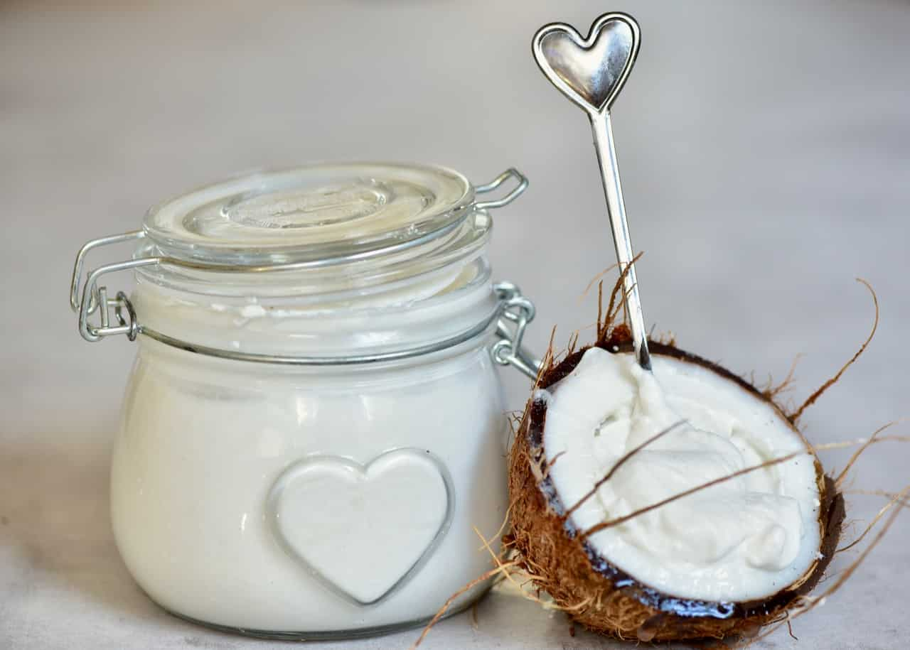 This delicious, super simple home-made coconut yogurt recipe is made with just 3 ingredients and yields a perfectly thick and tangy dairy-free yogurt!