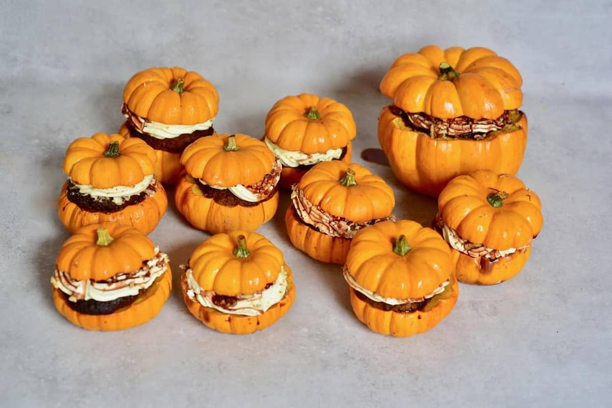 mini pumpkin cakes with coconut cream frosting and pecans