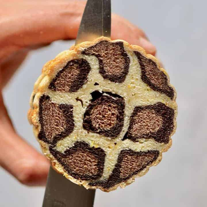 slicing through vegan leopard cake