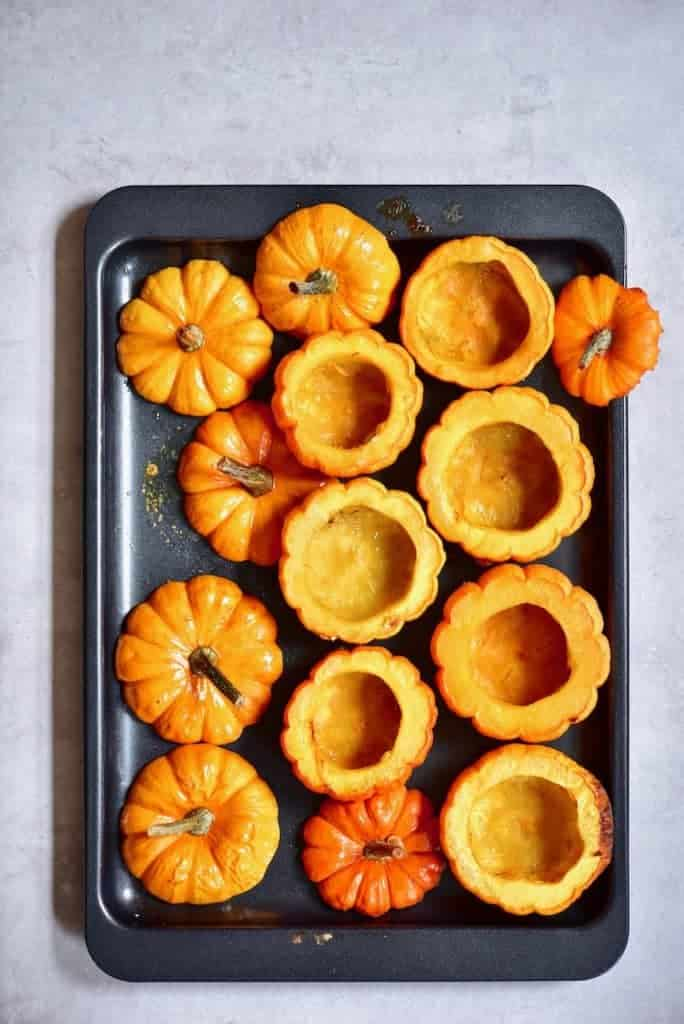 baked mini pumpkins on a tray