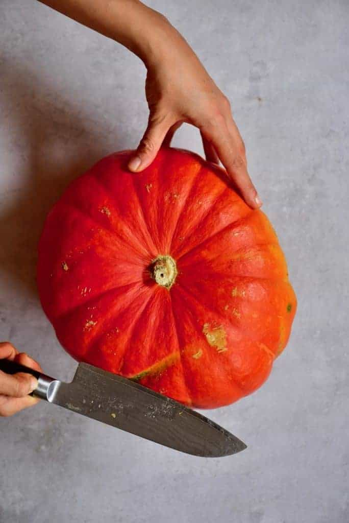 Opening a pumpkin with a knife