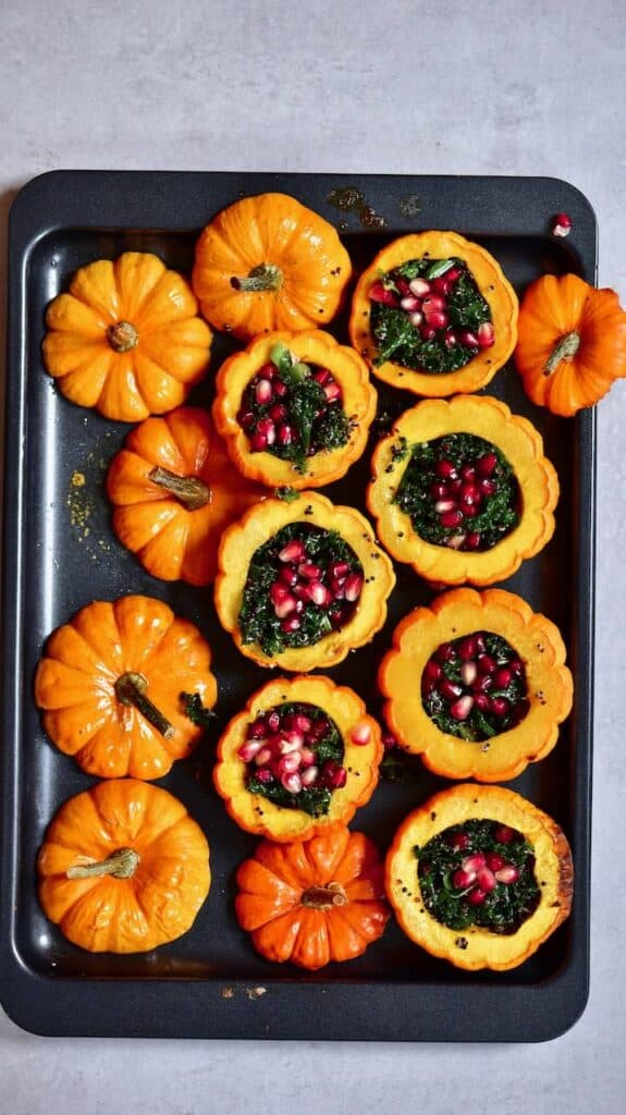 Vegan pumpkin, quinoa & kale salad served inside mini pumpkins. A delicious healthy fall salad that's a perfect vegan thanksgiving recipe and vegan pumpkin recipe as well as just a healthy fall salad. wonderful mini pumpkin recipe.