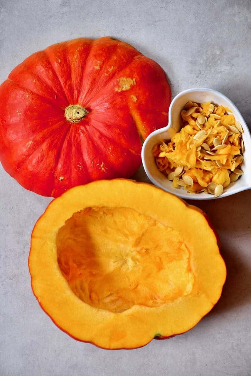 Deseeded pumpkin and seeds on the side