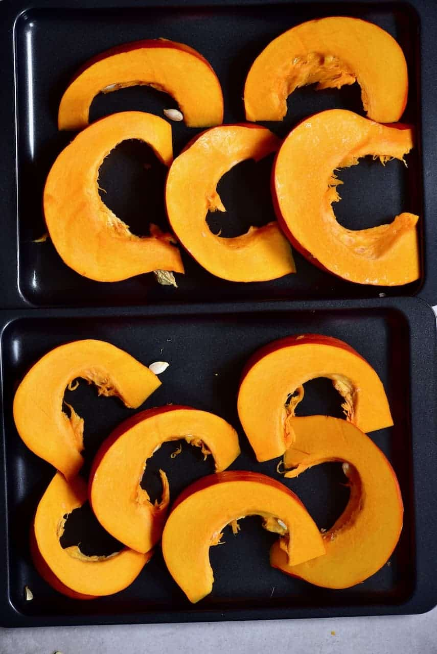 sliced pumpkins on a baking tray
