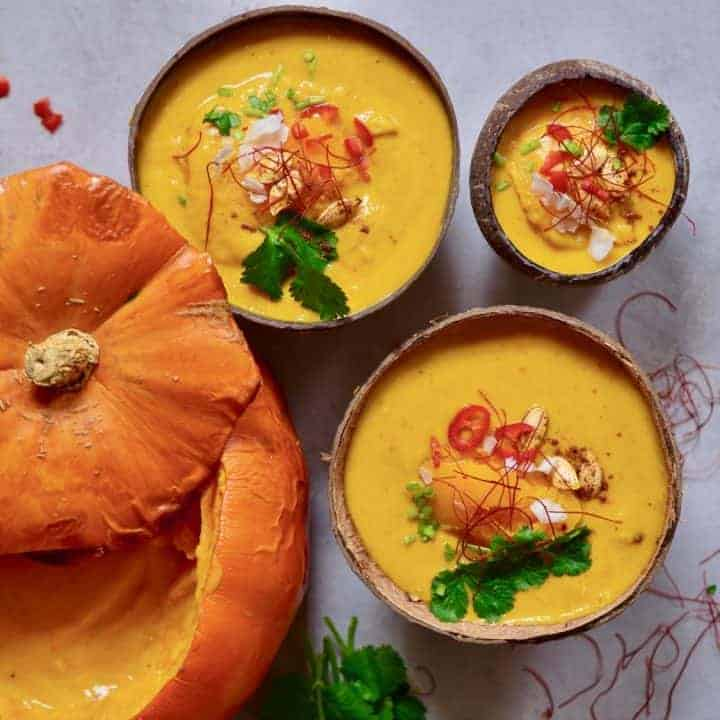 This coconut curry pumpkin soup uses just 15 ingredients and is a great easy pumpkin recipe for leftover pumpkins. Plus, it's 100% vegan and served in a pumpkin or coconut bowls