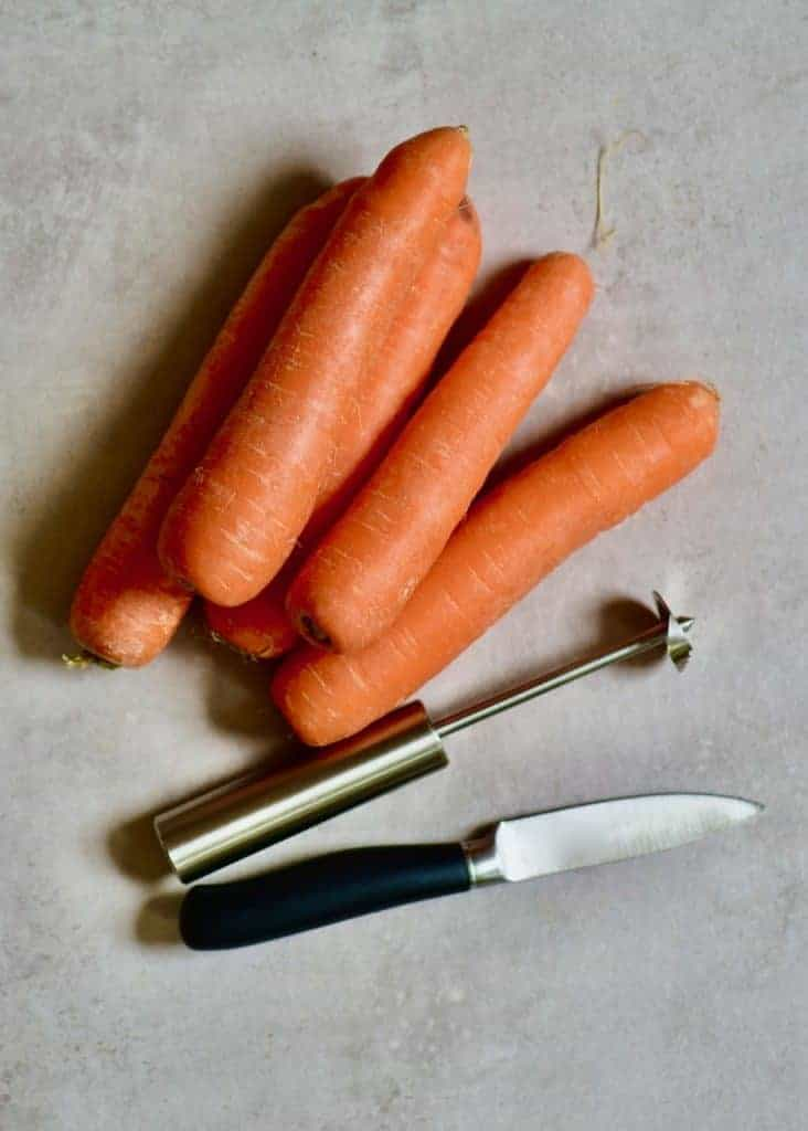 carrots with a knife and corer