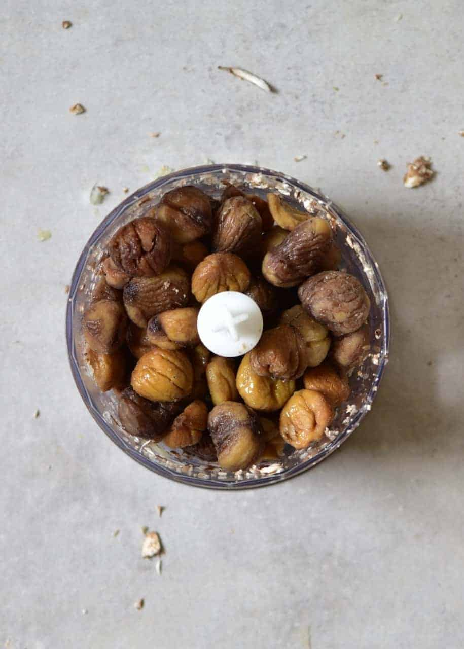A small blender bowl filled with chestnuts