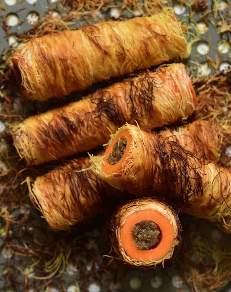 Delicious mushroom and chestnut stuffed carrots (tree logs) wrapped in shredded phyllo pastry. A unique vegetarian main, perfect for a vegetarian Thanksgiving or Christmas dish or special occasion recipe! Vegetarian ( easily veganised), grain-free, paleo, healthy & delicious fun baked carrots recipe!