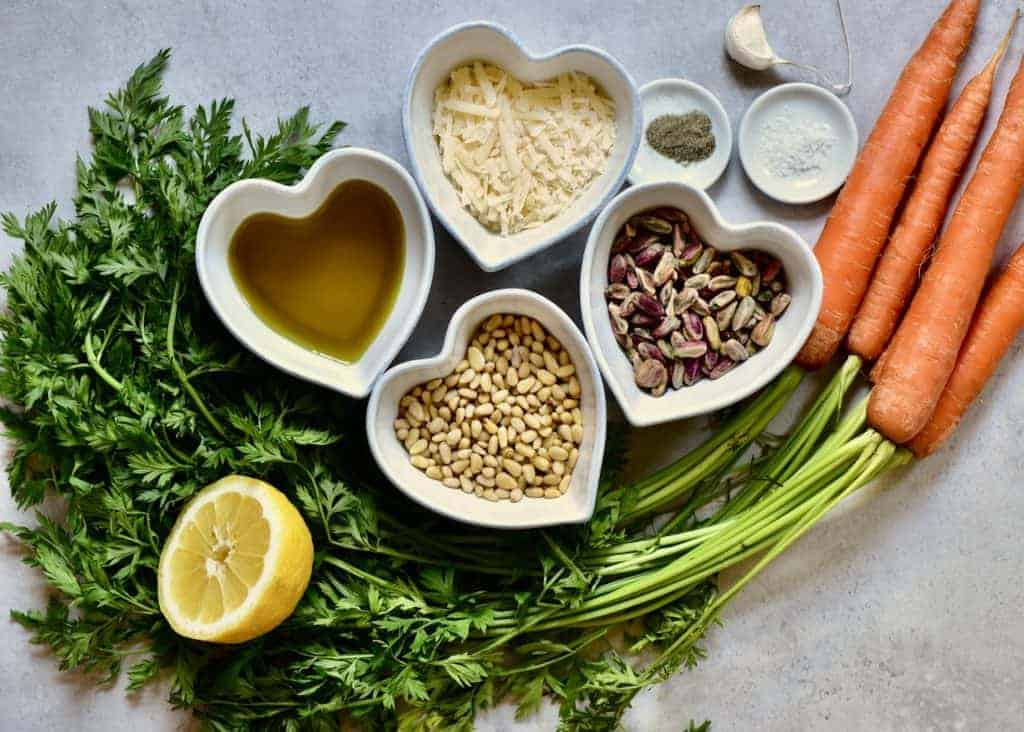 Ingredients for a vegetarian carrot leaf pesto waste reduction recipe