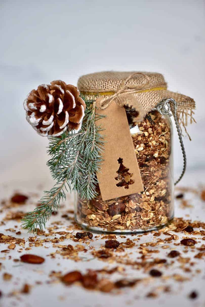 A jar with homemade Christmas granola, perfect for gifting