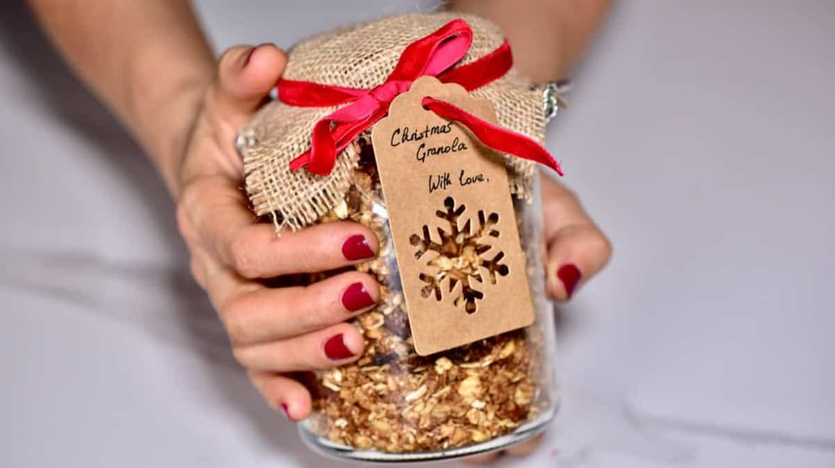 Christmas granola in a jar wrapped as a gift