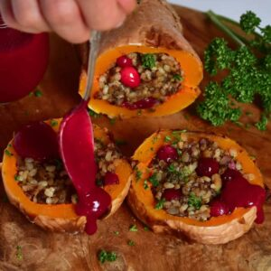 Delicious rice,mushroom & cranberry vegan stuffed butternut squash christmas recipe. A wonderful vegan roast alternative for a meat-free christmas