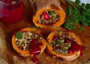 Delicious rice,mushroom & cranberry vegan stuffed butternut squash christmas recipe. A wonderful vegan roast alternative for a meat-free christmas