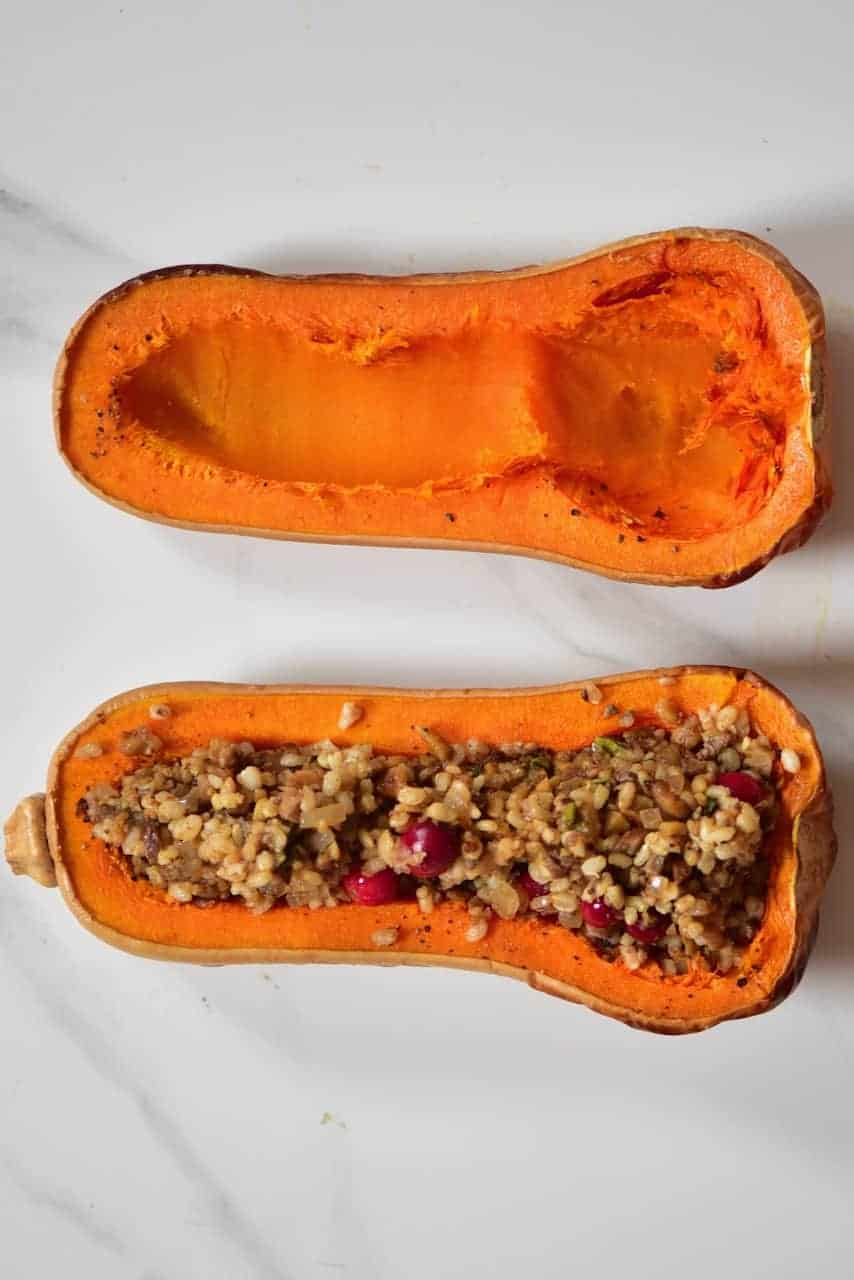 Vegan Christmas recipe of a maple-glazed roasted stuffed butternut squash with rice,mushroom & cranberry