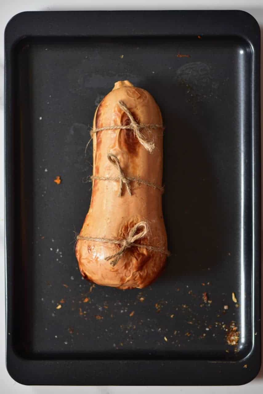 Vegan Christmas recipe of a maple-glazed roasted stuffed butternut squash with rice,mushroom & cranberry