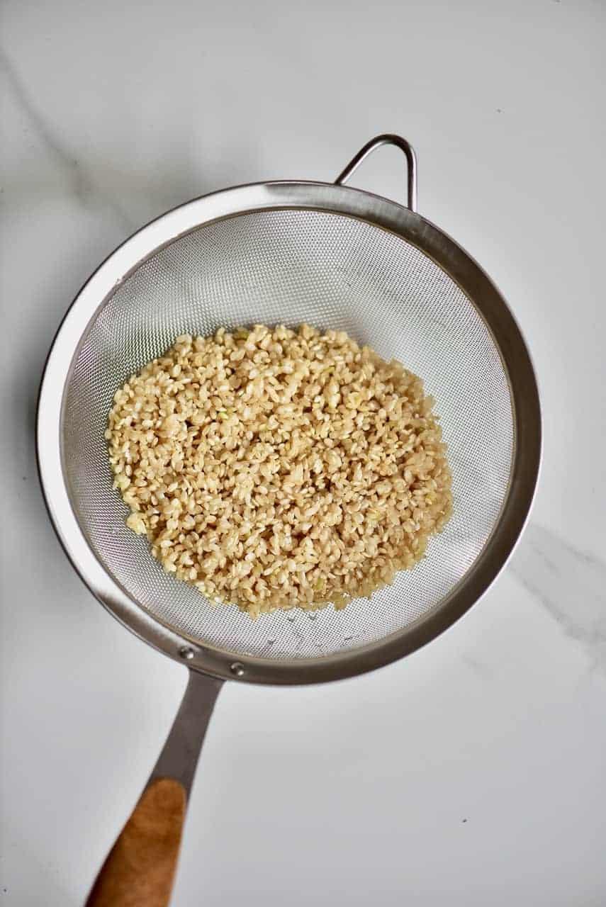 rinsed rice in colander