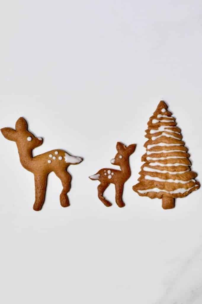 Christmas gingerbread cookie recipe plus a mini gingerbread house gingerbread mug topper