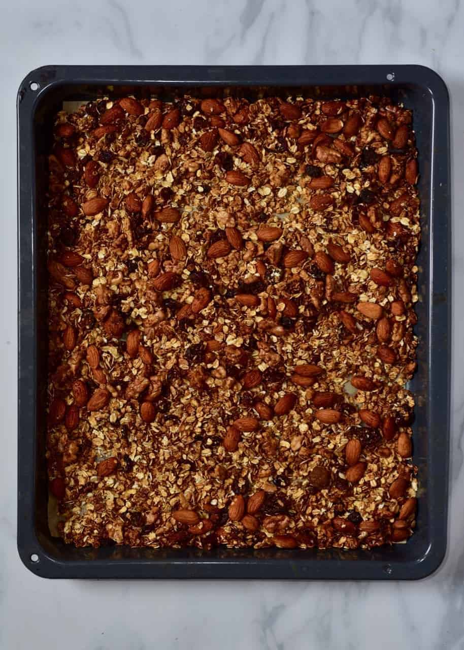 freshly baked granola in a baking tray