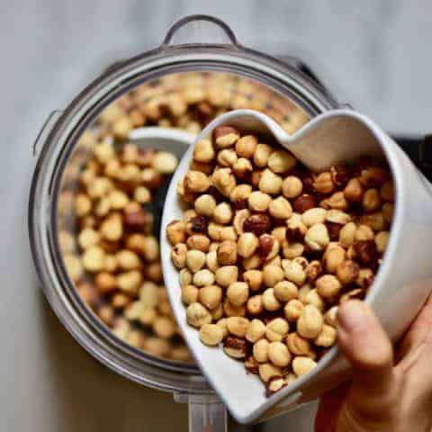 A delicious ONE ingredient homemade hazelnut butter recipe with flavoured hazelnut butter options, health benefits of hazelnuts & hazelnut butter uses!
