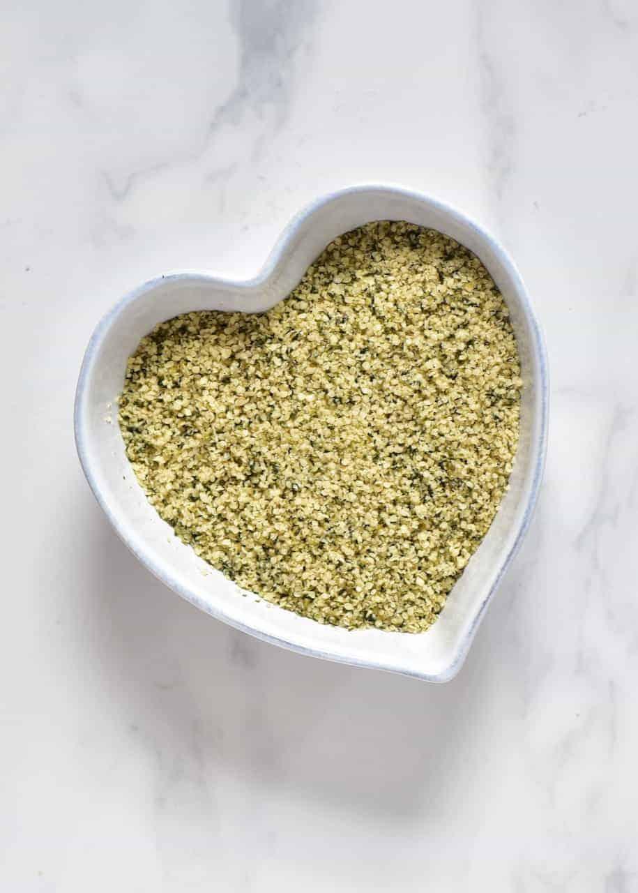 shelled hemp seeds in heart bowl