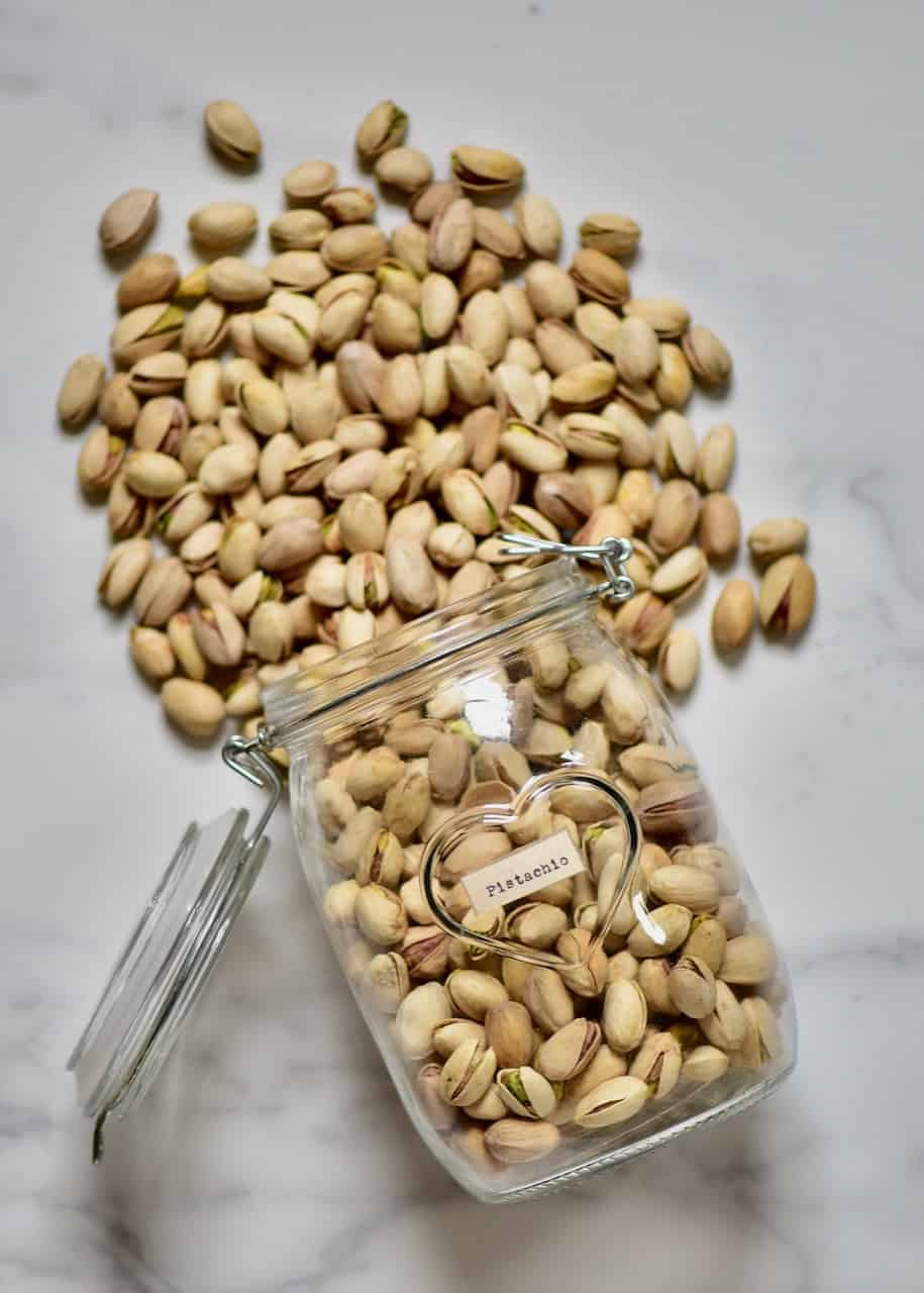pistachios spilling from a jar