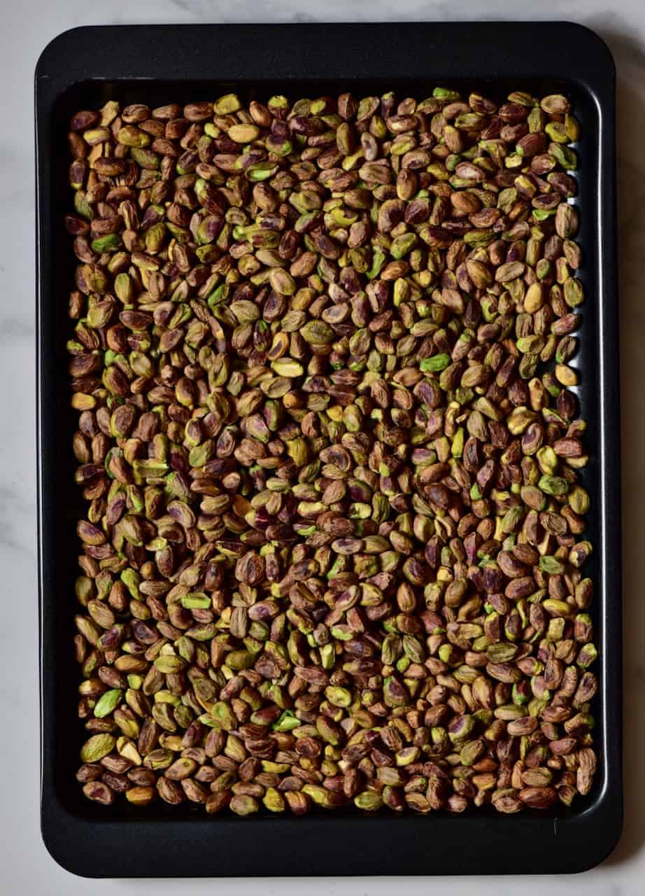 toasted pistachios in a baking tray