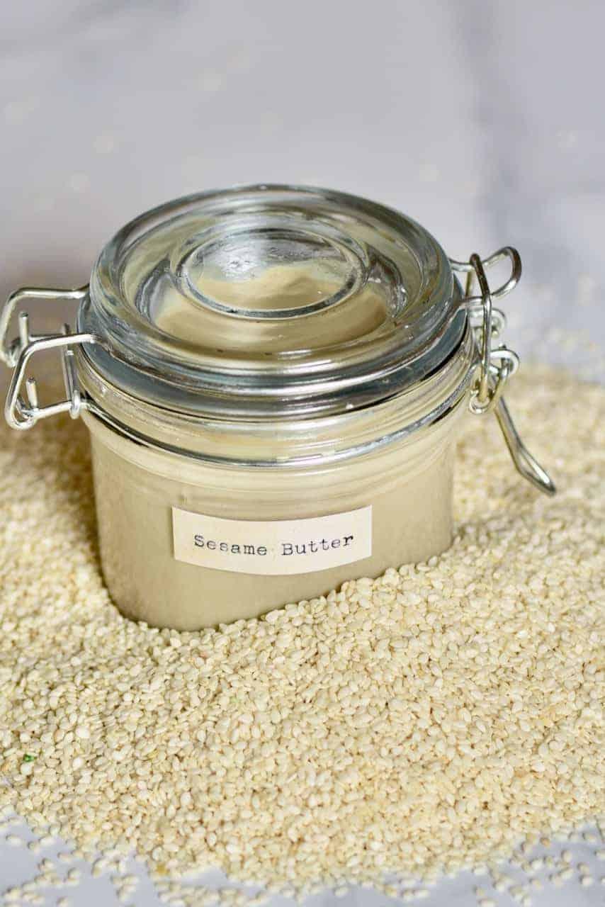 Homemade tahini (sesame butter) and sesame seeds