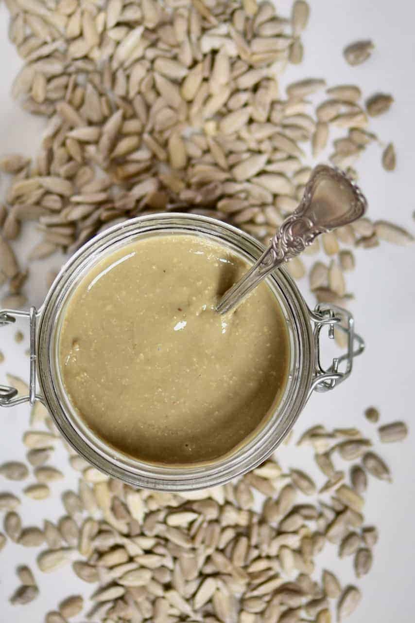 top view of a jar with sunflower butter and a spoon