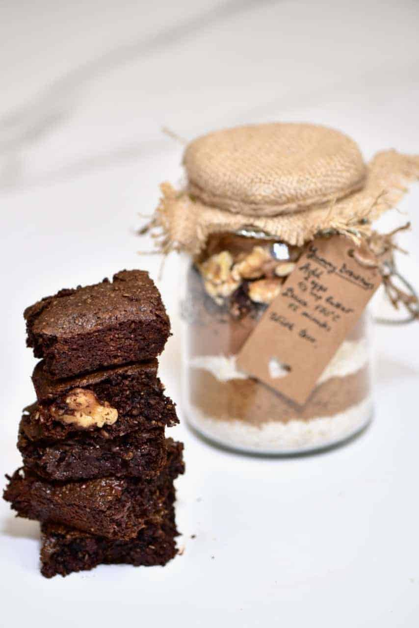 A lovely gluten free Christmas gift brownie in a jar. A cheap edible Christmas gift option that can easily be made in advance and Veganised.