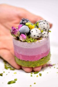 Delicious ombre pink and green raw vegan no-bake cheesecake with a gluten-free pistachio base and cashew nut based cherry cheesecake filling!