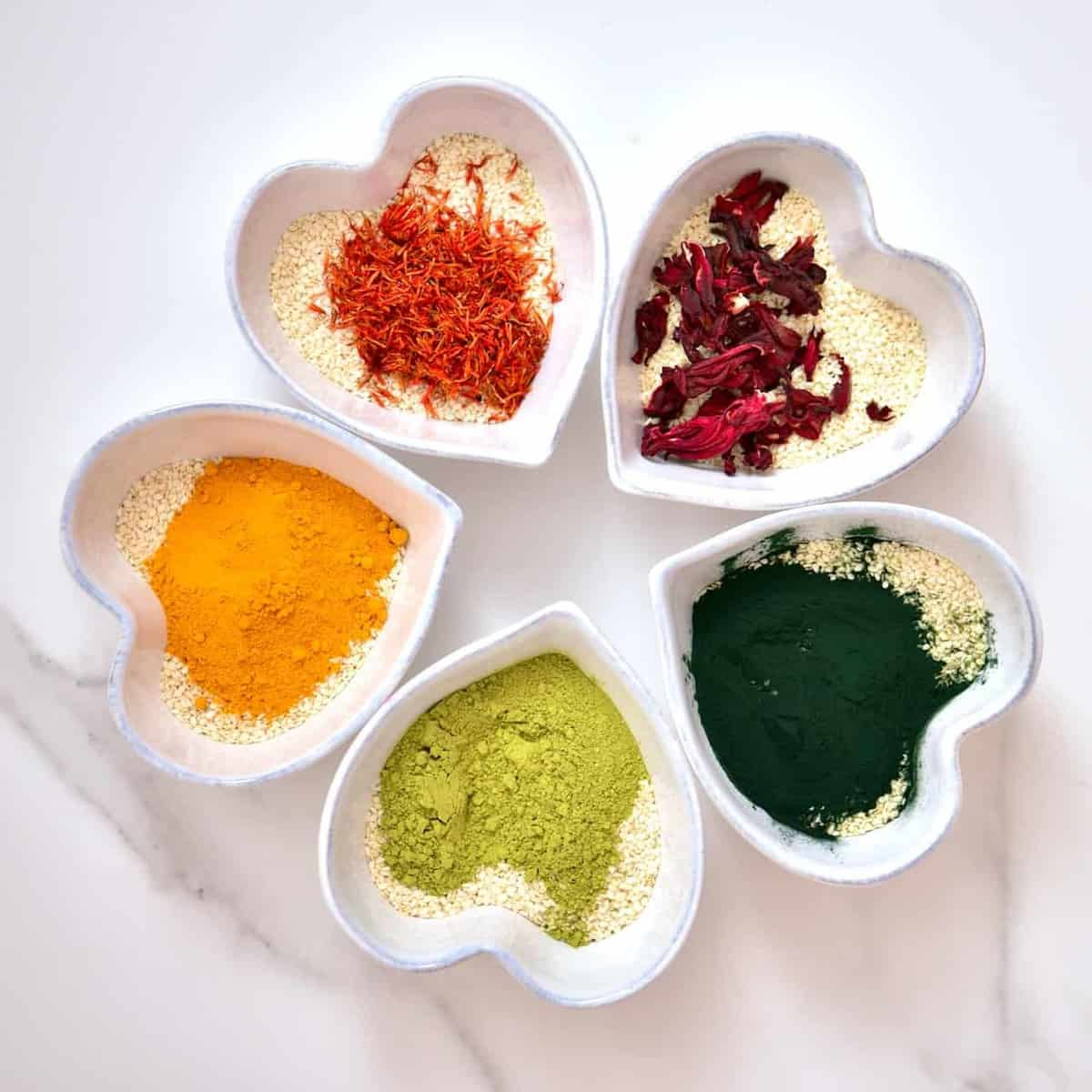 superfood powders and dried flowers being used to make all-natural food colouring options to colour sesame seeds