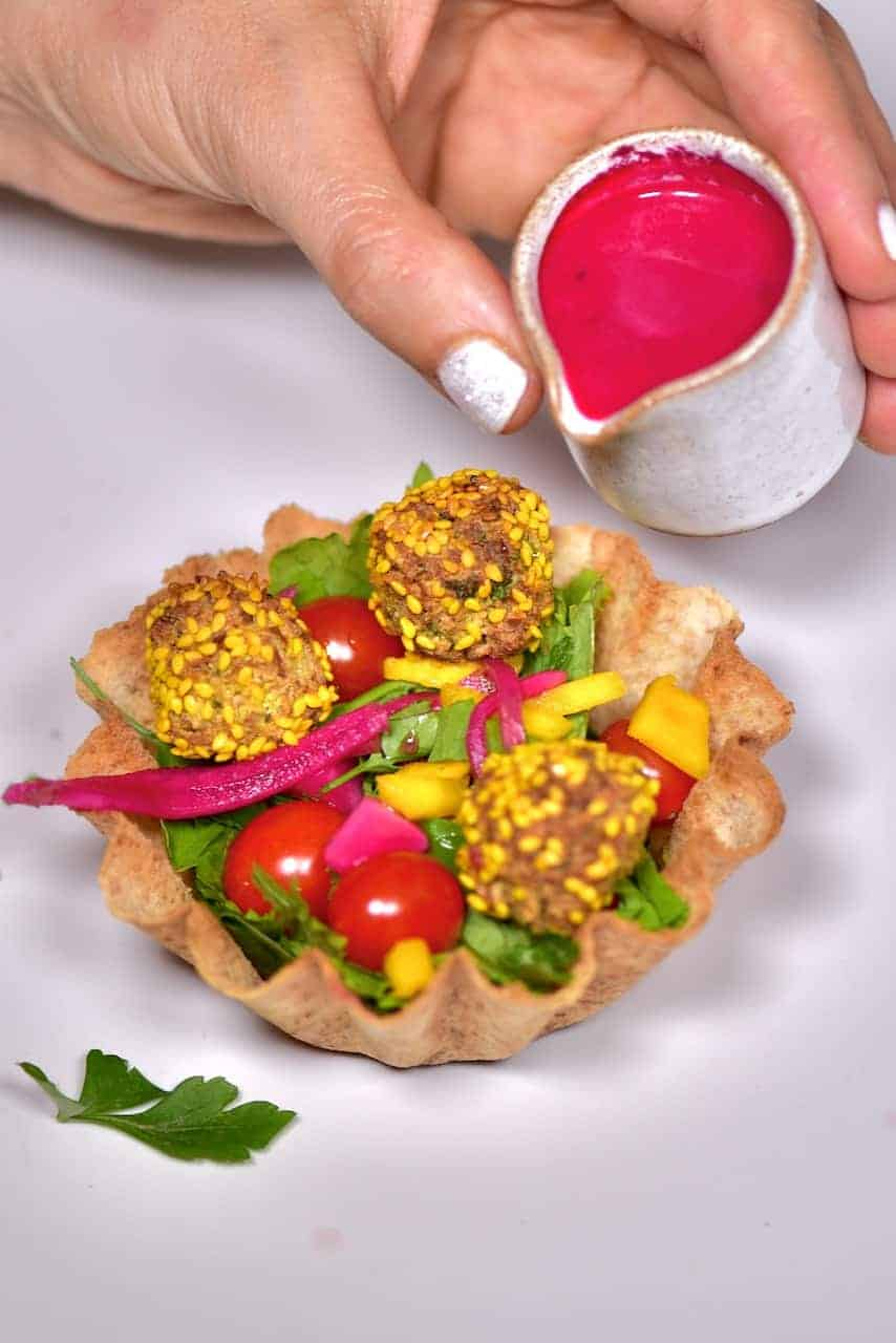 Vegan falafel recipe for popcorn falafel cups. A delicious vegan party food or easy vegan appetizers recipe; mini popcorn falafel served with a salad inside a tortilla cup
