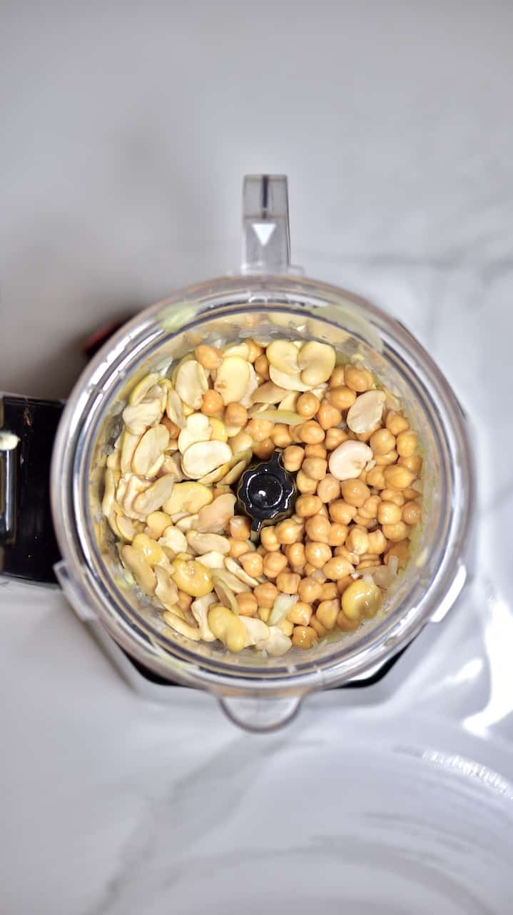 blending soaked chickpeas and fava beans for traditional falafel recipe