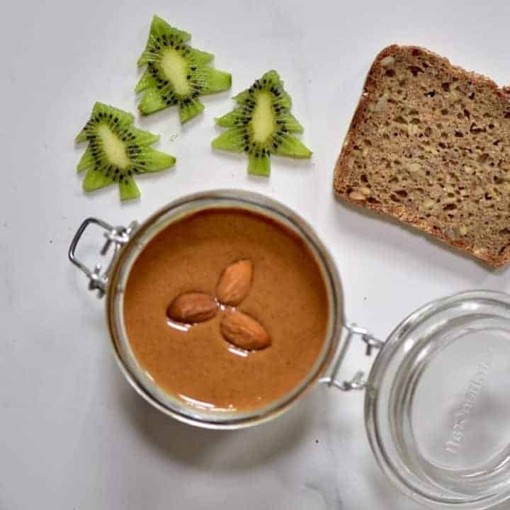 ingredients for healthy toast with homemade almond butter and kiwi trees