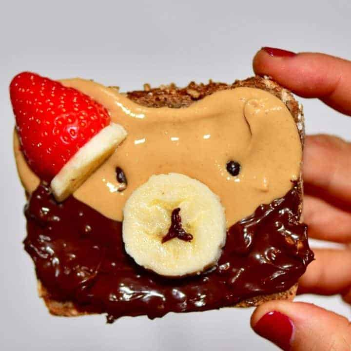 Christmas breakfast ideas perfect for christmas day breakfast - 9 healthy Christmas toast recipes including homemade nut butters, coconut yogurt and fruits. Plus these are easy Christmas recipes for Children - Christmas bear toast with homemade cashew butter and vegan nutella