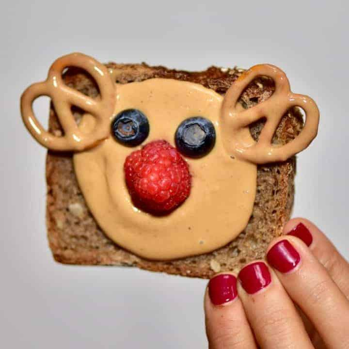Christmas breakfast ideas perfect for christmas day breakfast - 9 healthy Christmas toast recipes including homemade nut butters, coconut yogurt and fruits. Plus these are easy Christmas recipes for Children . Reindeer toast with homemade nut butter and fruit